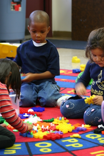 Montessori preschools encourage children to explore and play with objects to learn about different subjects.